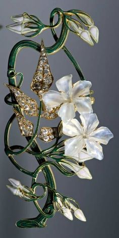 Lalique 1899-1901 'Jasmine' Corsage Ornament: 18k gold/ diamond leaves/ mother-of-pearl flowers/ green enamel. Muse Lalique, Rue du Hochberg, Alsace, FR