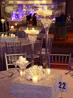 Re-create this beautiful design using out martini cases filled with crystals and floating candles.