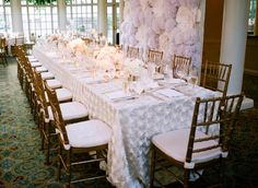 head table with flower paper wall from reception  from DC Garden Wedding at Fairmont Hotel   Photo: Hannah Hudson Photography