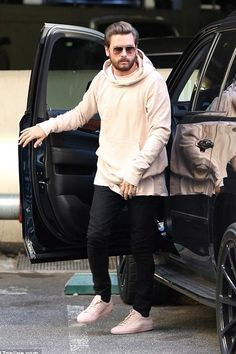 Scott Disick wearing Saint Laurent Skinny-Fit 17cm Hem Raw Stretch-Denim Jeans, Common Projects Original Achilles Sneakers in Pink and Saint Laurent Aviator-Style Gold-Tone Sunglasses