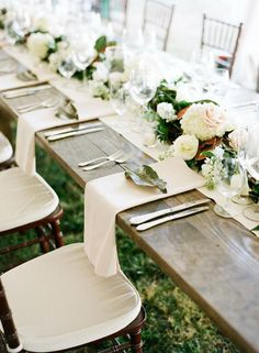 Fold the napkin in thirds lengthwise, then elegantly drape the ends down the side of the table | Brides.com