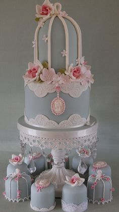 Pink & creams spings blossom. Wedgewood Birdcage Cake. Matching mini cakes.