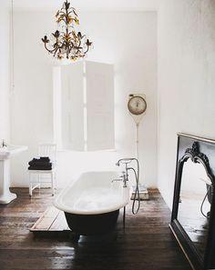 Rustic Wooden Floor, Black Roll Top Bath and Antique Mirror | Bathroom