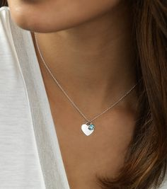 A shimmering, bezel-set blue topaz comes paired with a polished silver heart in this pretty pendant. The delicate charms are strung on a classic cable chain that can fasten at either 16 or 18 inches, making it a perfect layering piece. Topaz Birthstone, Birthstone Pendant, Gamine Style, Blue Nile, Fashion Jewelry, Women's Fashion, Blue Topaz, Birthstones, Classic Style