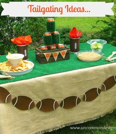 Such a cute tailgate party set up. I'm loving the burlap + football banner.