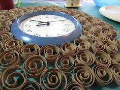 How to make a fancy filigree wall clock with toilet paper tubes!
