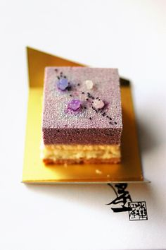 Purple sweet potato and coconut cakes: regular and purple sweet potato sponge cake filled with coconut cream topped with tiny spiky sugar candies called konpeito.