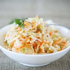 Win your next picnic or cookout with these easy coleslaw recipes. Find the best coleslaw recipes here, whether you like your slaw creamy or tangy. Simple Slaw Recipe, Chick Fil A Coleslaw Recipe, Coleslaw Recipes, Paleo Coleslaw, Slimming World Recipes Syn Free, Carrot Slaw, Creamy Coleslaw, Sauerkraut Recipes, Coleslaw