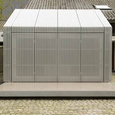 Studio R-1 by architecten       wrapping a garage in corrugated aluminium.