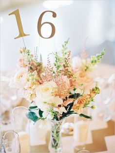 table number ideas and centerpiece ideas #weddingflorals #weddingreception #weddingchicks http://www.weddingchicks.com/2014/04/04/black-tie-oregon-wedding/