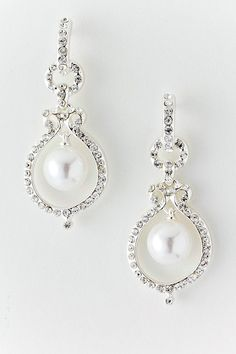 $40 Stunningly gorgeous, Austrian Crystals delicately cradle a single White Pearl.