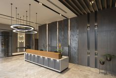 The sales office has been designed for marketing and sales purposes. Reception Counter Design, Office Reception Design, Office Space Design, Office Interior Design, Lobby Interior, Interior Ideas, Office Entrance, Entrance Design, Office Lobby