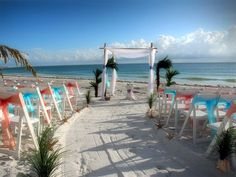 An island oasis with a gently sweeping aisle and a blend of sashes against a perfect Florida sky. At Suncoast Weddings, every detail counts.