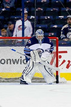COLUMBUS, OH - APRIL 6: Eric Comrie #1 of the Winnipeg Jets warms up prior to making his NHL debut during the game against the Columbus Blue Jackets on April 6, 2017 at Nationwide Arena in Columbus, Ohio. (Photo by Kirk Irwin/Getty Images)