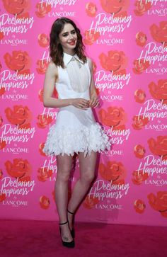 Model and actress Lily Collins poses at the red carpet of the opening ceremony of Lancome 'Declaring Happiness' exhibition on June 21 2017 in...