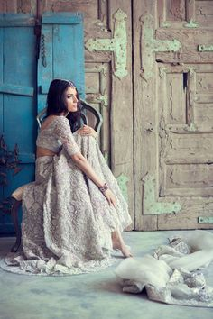Meera Ansari posing for Elan bridals.