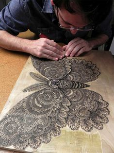 """Paul Roden and Valerie Lueth over at Pittsburgh-based Tugboat Printshop just announced a new woodcut print titled Moth. Shown in production here, the final piece will be a 2-color print measuring 18"""" x 25"""" and is now available for pre-order. Art and design blogs everywhere were s"""