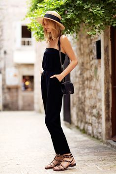 black jumpsuit with straw hat