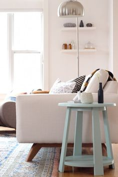 Light blue side table and white sofa