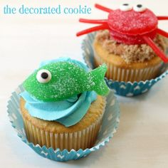 """To frost the cupcakes, I just filled a decorating bag fitted with a size """"1M"""" tip with blue frosting and piped swirls. For the sandy cupcakes, I frosted the cupcakes with brown frosting and dipped the tops in light brown sugar. Then I topped with candy and instant beach scene."""