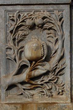 Door detail of a pomegranate, symbol of Granada
