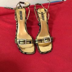 Gold Sandals Beautiful gold and black with diamond like buckle, gently worn. First Sight Shoes Sandals