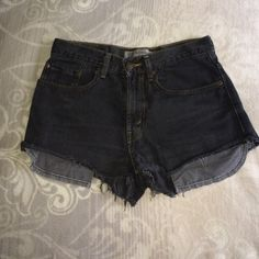 Urban Outfitters Levi's shorts Size Small. Black Distressed shorts with pocket revealing detail. High waisted. Worn once. Open to reasonable offers. EUC. Urban Outfitters Shorts Jean Shorts