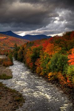 It's one of my favorite times of the year up in New Hampshire.  The leaves start to change, and the weather is delightfully unpredictable.  -White Mountains, NH along Kangamangus Highway by RamblingPhotog, via Flickr