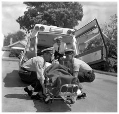No electric cots when I started in EMS. This was the original way of loading a patient into the back of the ambulance. The 2 person lift and maybe 4 if they were real large and you were lucky to have the help. This is why I have no back left after 28 years.