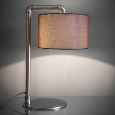 This hotel style table lamp with its smart nickel finish and fabric shade is perfectly chic and will add style to your lounge or bedroom as a bedside