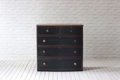 Victorian mahogany bow fronted 2 over 3  chest of drawers.   Fully restored (sanded, sealed & waxed) and newly painted black front drawer detail.