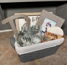 This newlywed gift includes a sign with your choice of a custom message and design, set of Mr. & Mrs. Drinking glasses plus coasters, 1 candle, metal or wood letter sign or comparable with the couples first letter of their last name, and a picture frame for their first photo as a married couple! Check these 15 best engagement gift basket ideas for couples. You will find a gift that every couple will love at any style or budget. Engagement Gifts For Bride, Engagement Humor, Wedding Gifts For Bride And Groom, Wedding Gifts For Guests, Wedding Welcome Bags, Wedding Gifts For Parents, Gift Table Wedding, Card Box Wedding, Wedding Anniversary Gifts