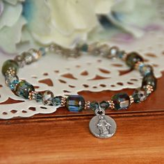 Beautiful shades of blue showcase your love of the Blessed Mother in this Marian bracelet!