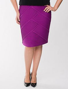 Figure-flattering diagonal pleats define modern femininity on this stunning skirt from the Lane Collection. Hitting below the knee with a vented back, this fun twist on the classic pencil skirt is ideal for office or social occasions in smooth, durable ponte knit. Hidden zipper and hook & eye closure. lanebryant.com