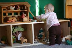 I WANT a cubby set like this for our toys!  Maybe put baskets in the cubbies to hold blocks, balls, cooking stuff, etc.