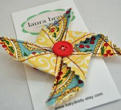 @Laura Bray  I had to do a double take... I thought you made this Pinwheel hairclip!  Check out this other Laura's Etsy shop.  You could totally make stuff like this and have Jon use his graphic arts skills to market you! :)