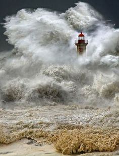 lighthouse in stormy water
