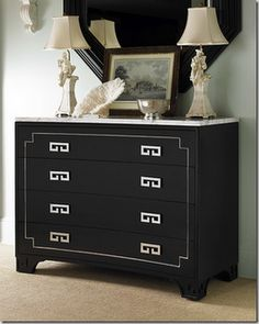 These drawer pulls are very different and create great contrast with this dark piece.