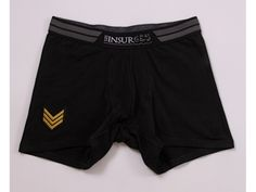 From the Trendy Military line, this black boxer brief has a waistband inspired by military stripe.    A golden emblem is placed on the right leg.
