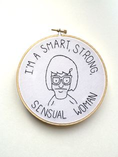 This embroidery features Tina Belcher, who in my opinion is the best character in Bobs Burgers, with a quote of hers done in black thread. The