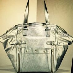 YSL Downtown Bag Silver Yves Saint Laurent Downtown Bag in gentle used condition. Fits a ton and this silver literally goes with anything. Dress it up dress it down, you're going to get so many compliments on this bag. Open to reasonable offers. Yves Saint Laurent Bags