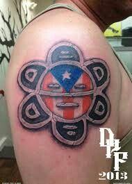 Sol Taino with Puerto Rican Flag Gangsta Tattoos, Dope Tattoos, Body Art Tattoos, Tattoos For Guys, Tatoos, G Tattoo, Armor Tattoo, Tattoo Drawings, Taino Tattoos