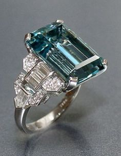 12.16 carat emerald cut aquamarine ring with baguette, bullet shaped and round diamonds set in platinum