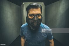 Stock Photo : Portrait of a Psycho inside a Labyrinth Room or Prison