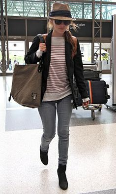 Wish I could be this chic at the airport. GODD I want her style.