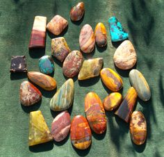 Stones from all over the world, made into cabochons for pendants, all hand polished and worked, no big grinding machines. Many rare and beautiful semi precious stones are too delicate to be worked on modern lapidary equipment, they must be hand polished on small often hand powered equipment, where a true feel for the stone can be had. All in the picture have been cut and polished by hand, they are quite beautiful.