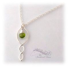 "Sterling Silver wire is twisted into a shape reminiscent of a shell, and from the top hangs a beautiful, genuine, Peridot. The shell-shape and the Peridot both hang separately from one loop that attaches them to the necklace, so everything can move independently. It's a bit like having two charms hanging from the same loop.   The pendant hangs from a 16"" flat cable chain.   More Peridot and other gemstones are available in The Feathered Mane's Etsy store."