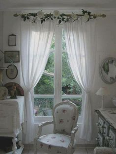 Lovely soft, white drapes with white flower garland.