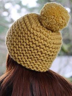 Free pattern - Large needles, super bulky yarn held double … you can whip up this cozy garter stitch hat in an evening. Don't forget to add a super-sized pom pom! Chunky Hat Pattern, Knit Beanie Pattern, Beanie Knitting Patterns Free, Knitting Yarn, Sweater Patterns, Knitting Tutorials, Hand Knitting, Knitted Hats, Crochet Hats