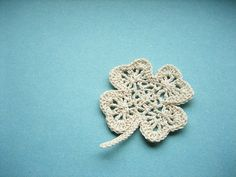 crocheted shamrocks -- wonder if a bunch of these could be made and joined into a table runner?